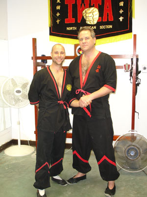 Sihing Jason Bolanz of Dallas, Texas, with his Si-Fu, Master Will Parker