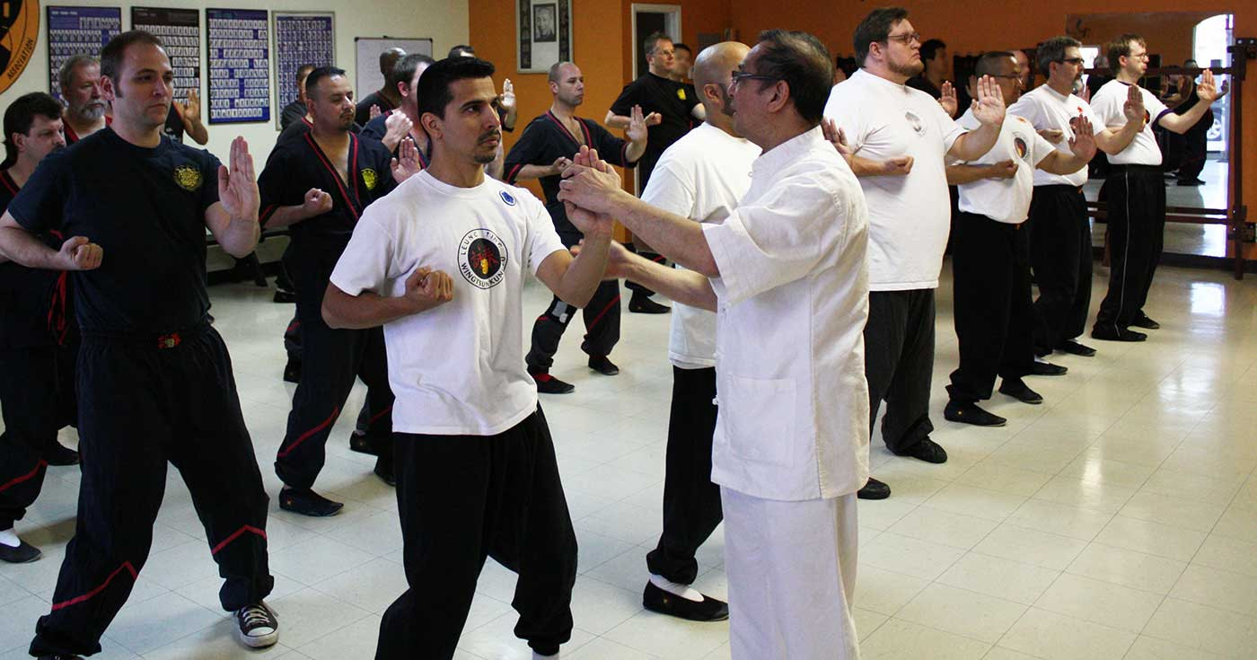 Photo: Great Grandmaster Leung Ting checks and corrects the WingTsun kung fu techniques of students and instructors at a seminar in San Antonio, Texas